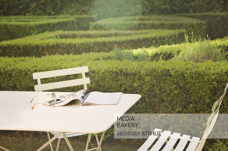 Magazine and Sunglasses on Table in Garden
