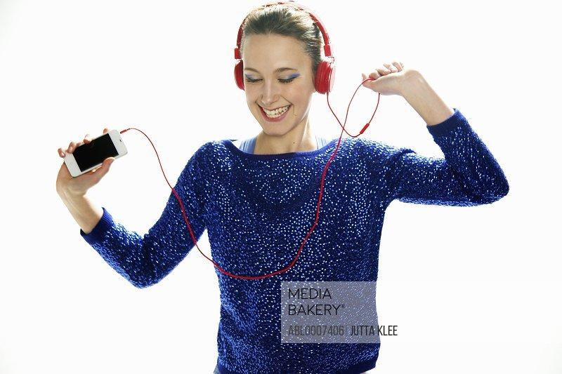 Teenage Girl with Headphones Dancing