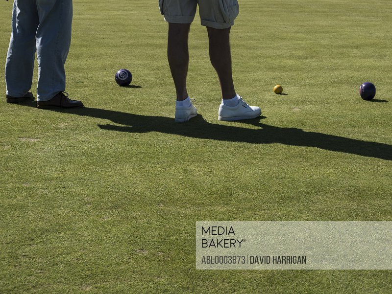 Men Playing Flat Lawn Bowls, Low section