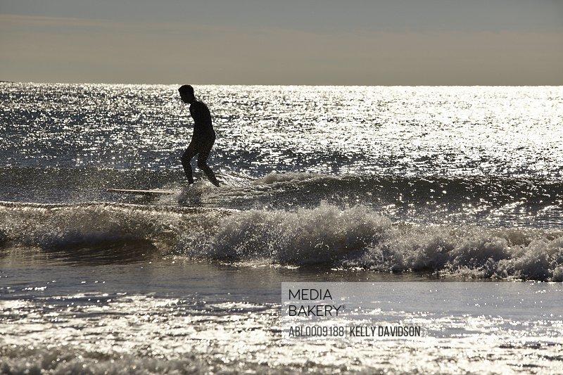 Surfer Riding Wave