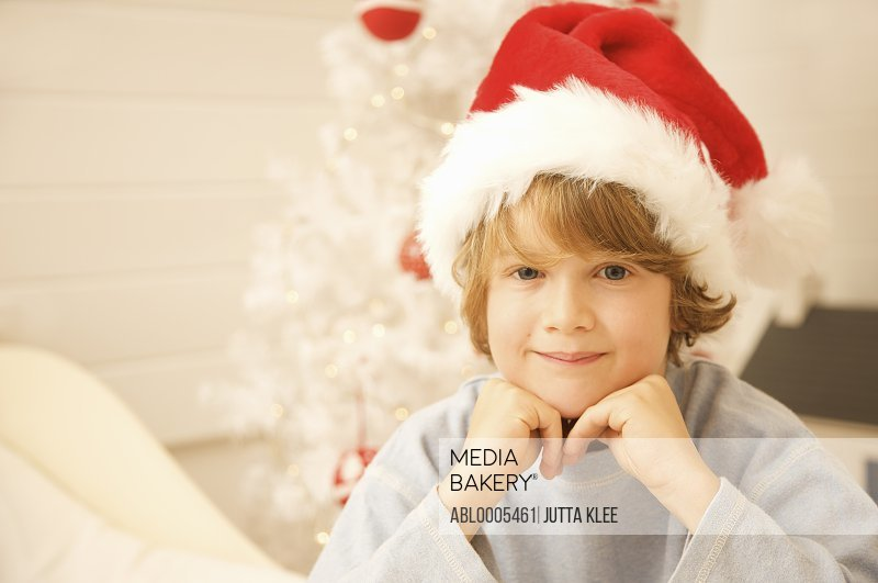 Boy wearing a red and white Christmas hat