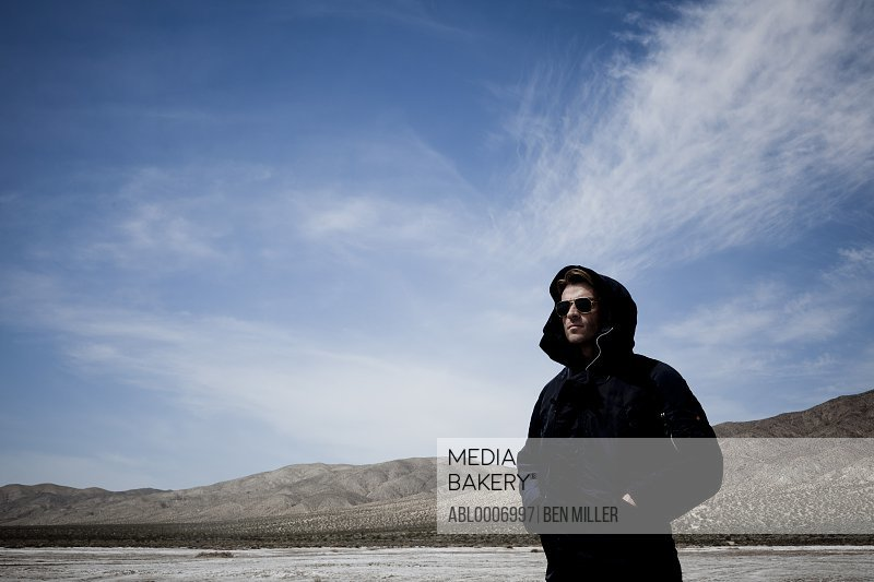 Man Wearing Hooded Parka Standing in a Valley