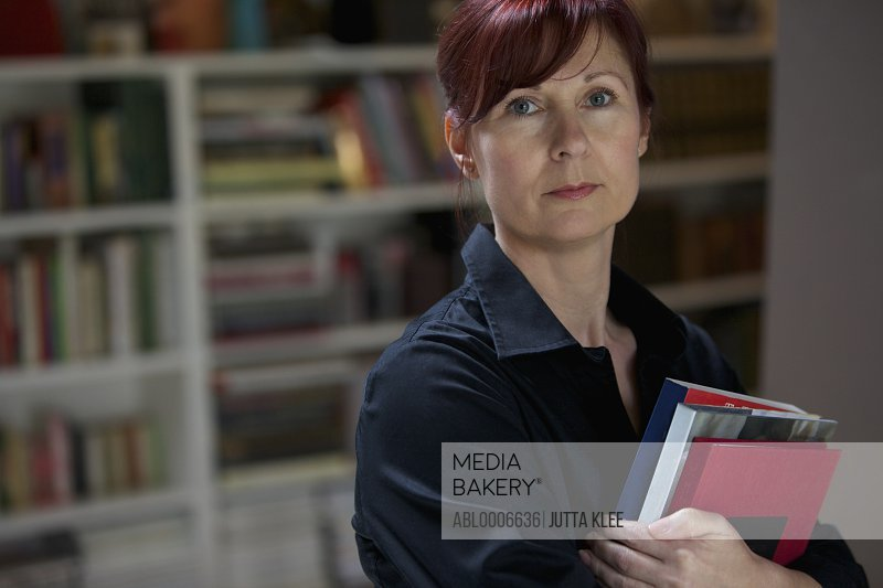 Businesswoman Holding Books