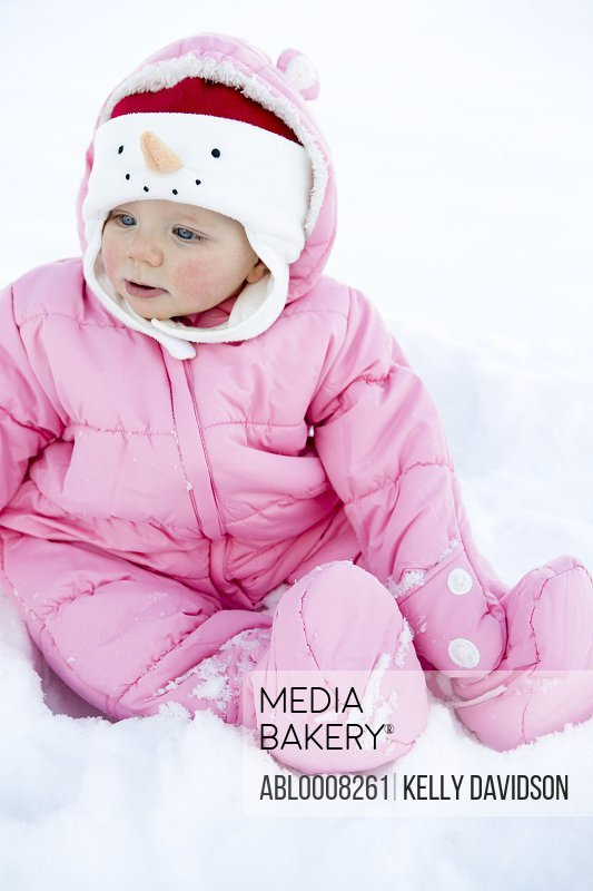 Baby Girl Sitting in Snow