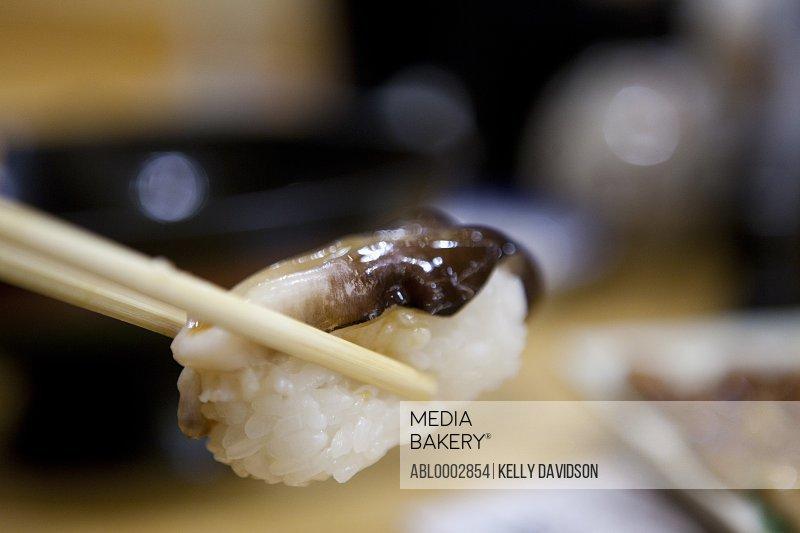 Sushi between Chopsticks