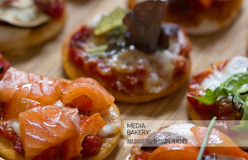 Mini Pizzas with Salmon and Vegetables