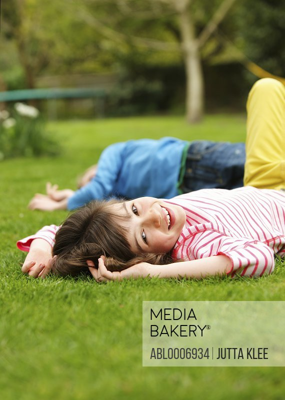 Young Girl Lying on Lawn