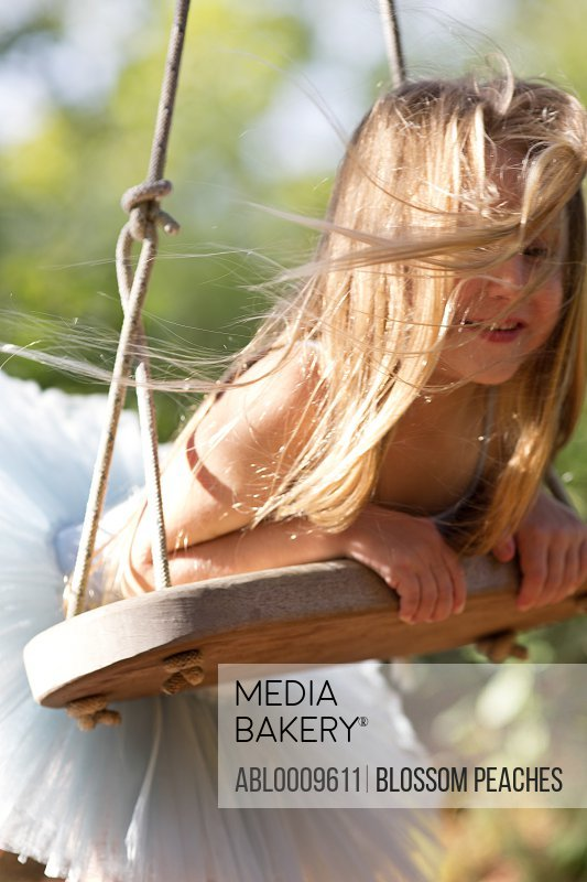 Young Girl on Swing, Close-up View