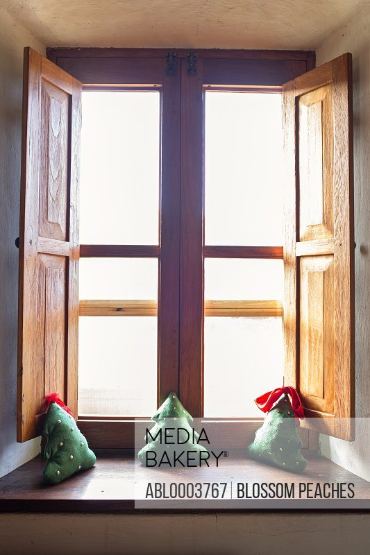 Three Cushions in the Shape of Christmas Tree on Wooden Window Sill