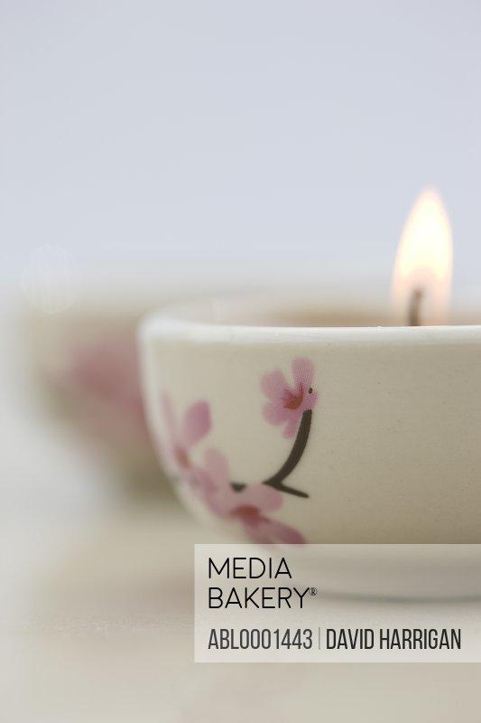 Close up of a burning pink tea light