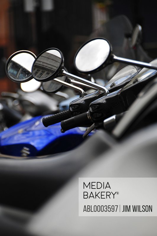 Row of Side-view Mirrors on Parked Motorcycles, Close-up View