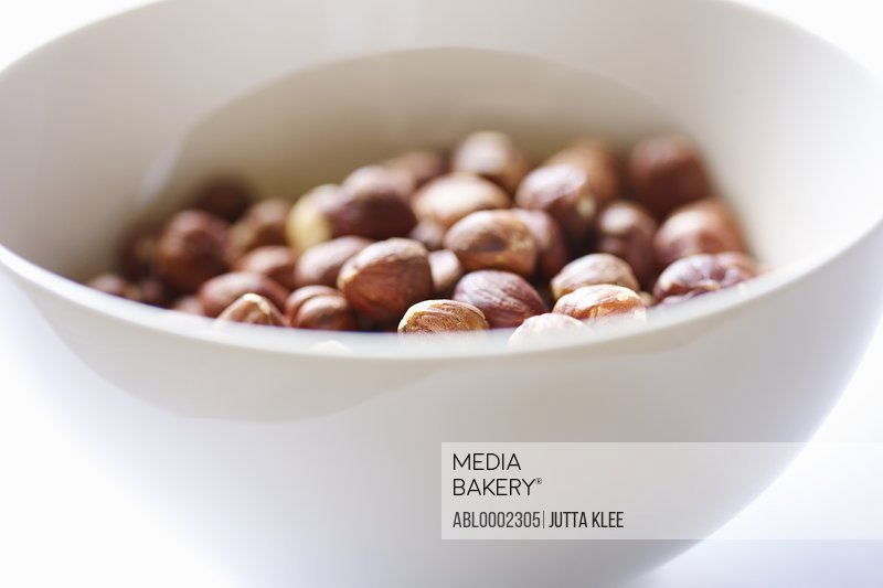 White Bowl Filled with Hazelnuts