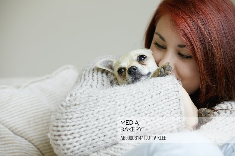 Teenage Girl Hugging a Chihuahua Dog