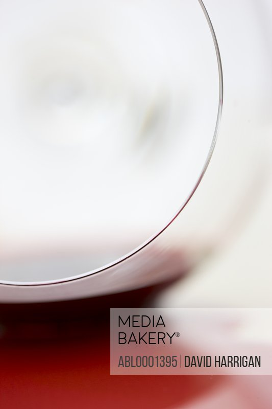 Close up of a glass with spilled red wine