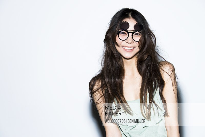 Smiling Woman Wearing Glasses with Flip Up Shades
