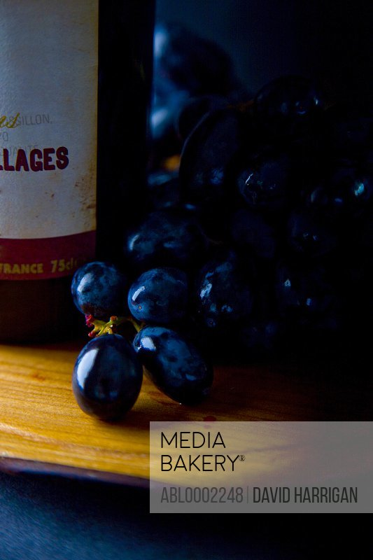 Black Wine Grapes and Wine Bottle