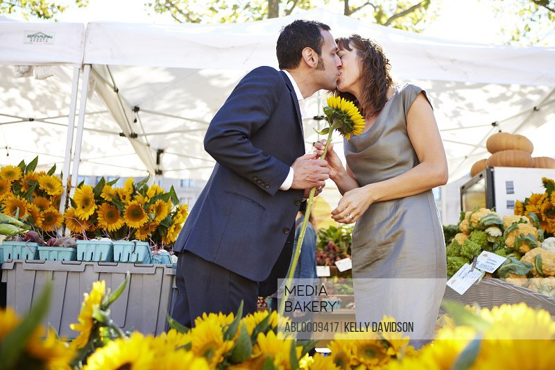 Couple Kissing at Farmers Market
