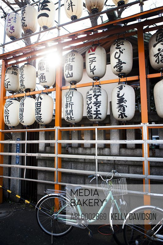 Japanese Lanterns and Parked Bicycle