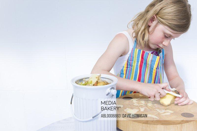 Young Girl Peeling Potatoes