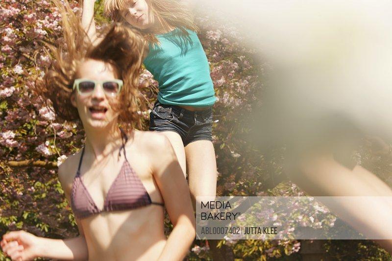 Teenage Girls Bouncing on Trampoline