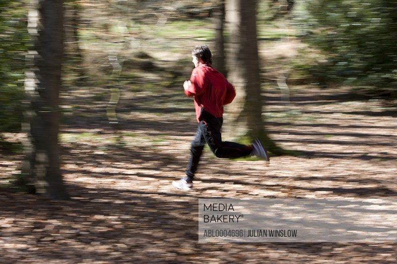 Portrait of a man running in the park