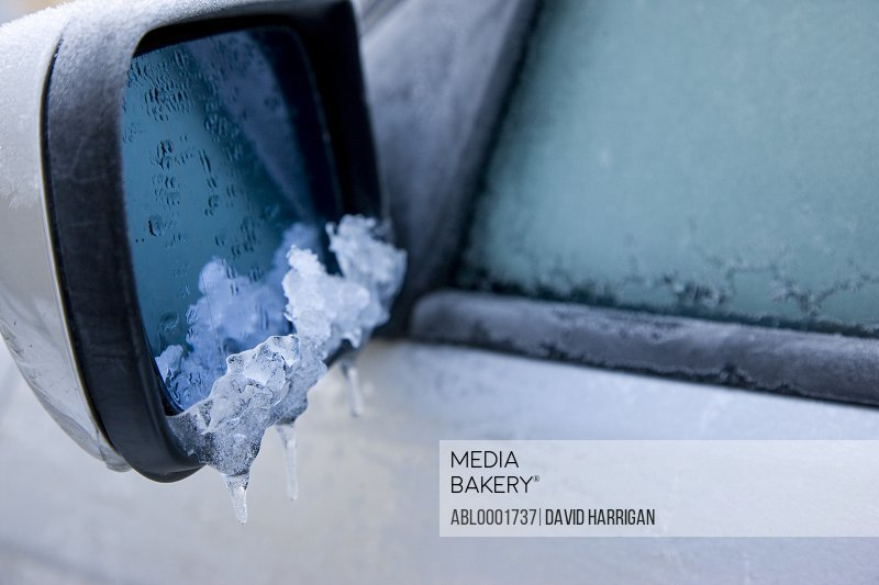 Icicles on a car wing mirror