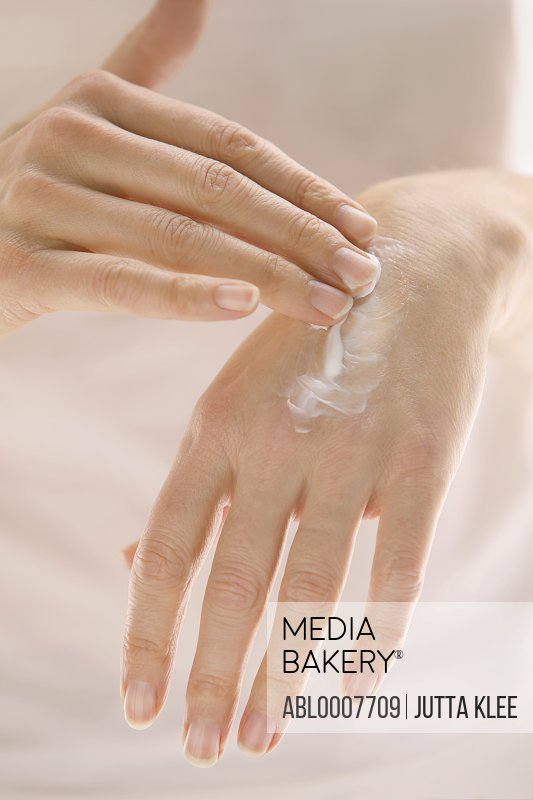 Woman Applying Hand Lotion, Close up view