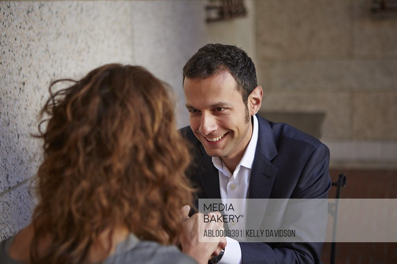 Man Holding Woman's Hands Smiling