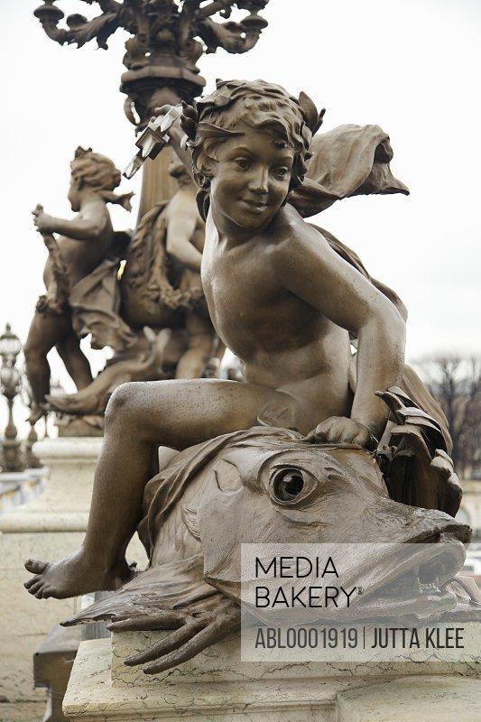 Bronze sculpture on Alexander III bridge, Paris, France