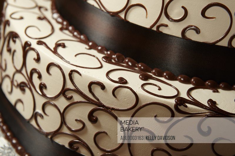 Cream Tiered Cake with Chocolate Decorations, Close-up view