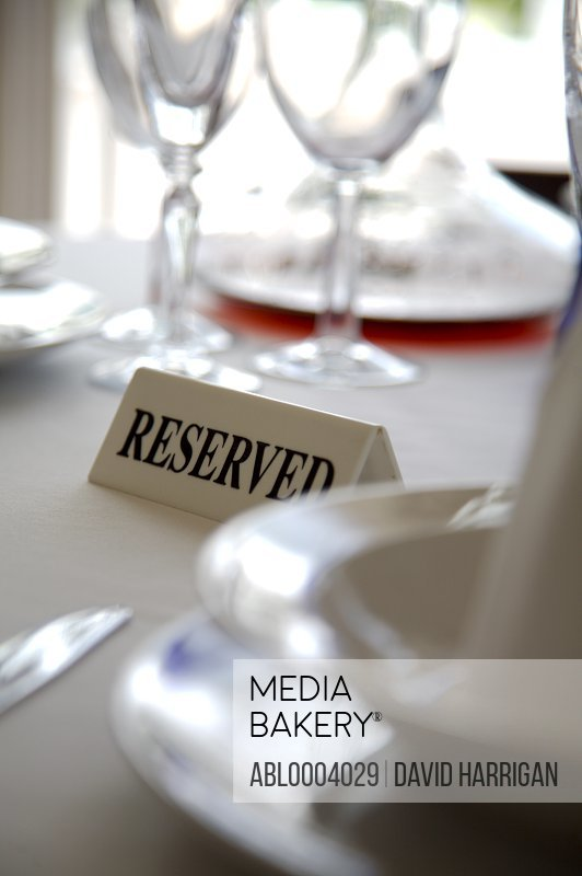 Extreme close up of tableware and reserved sign