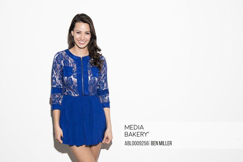Smiling Woman Wearing Blue Dress