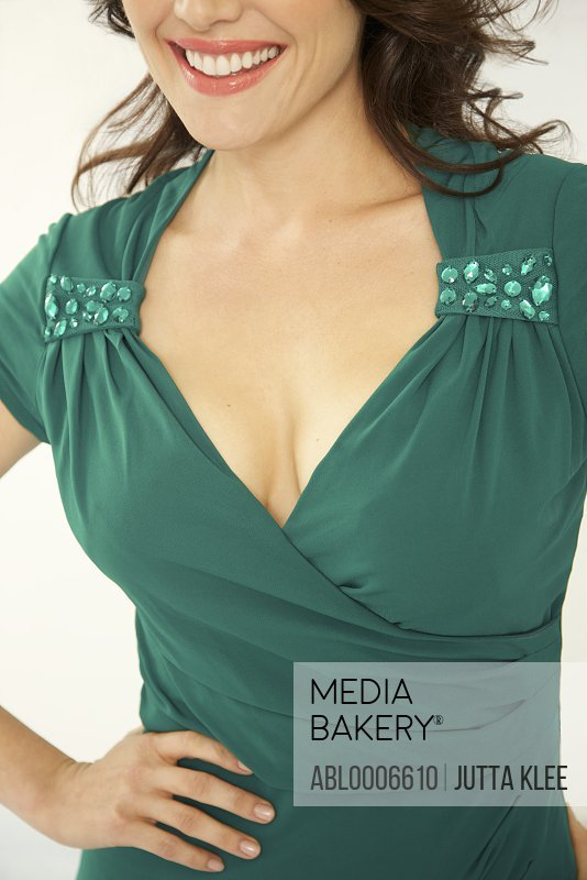 Smiling Woman in Green Dress