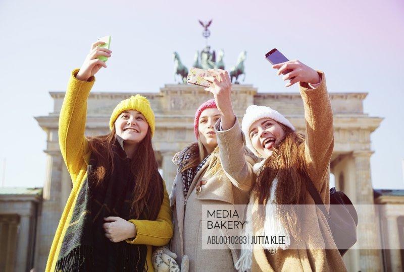 Teenage Girls Taking Selfie in front of the Brandenburg Gate, Berlin, Germany
