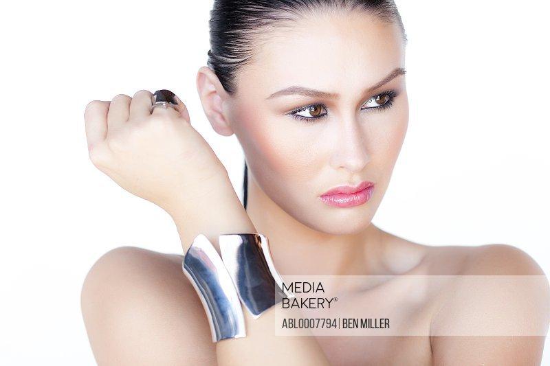 Portrait of Woman Wearing Silver Cuff Jewel