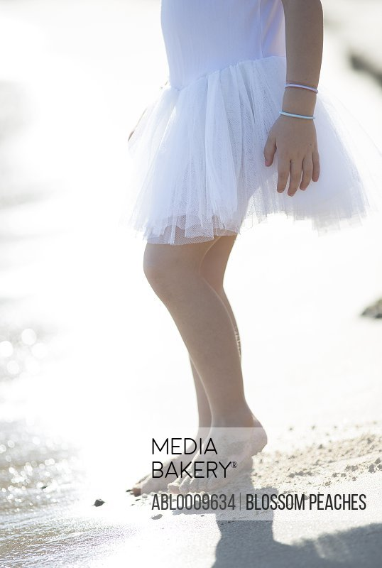 Side View of Girl Wearing Tutu on Beach, Low Section