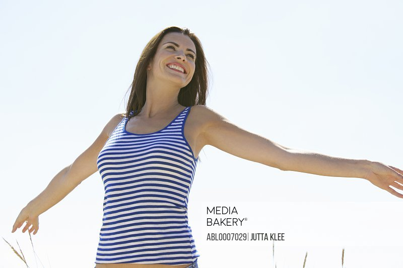 Woman with Arms Outstretched Outdoors