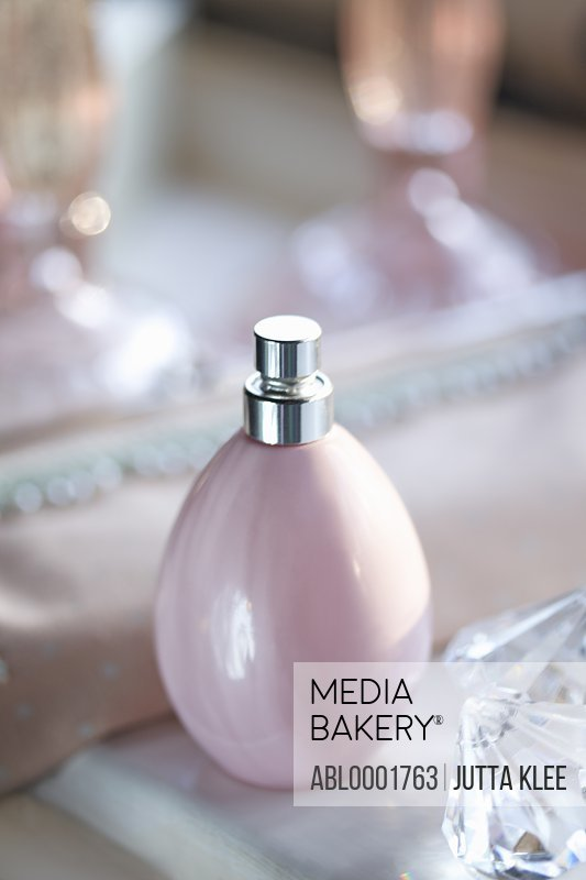 Close up of a pink perfume bottle