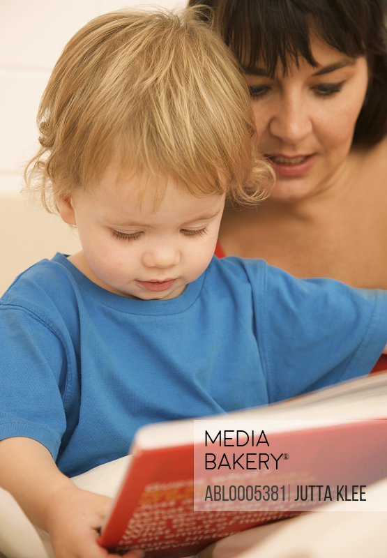 Woman with a child reading a bedtime story