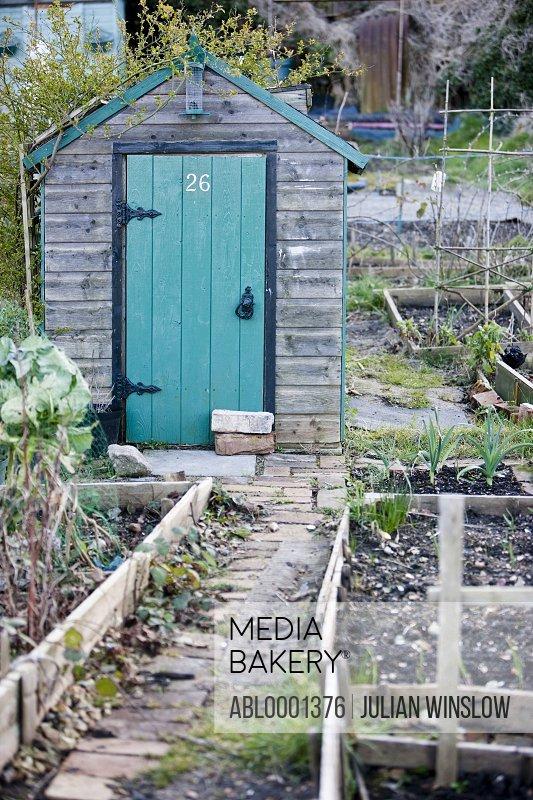 Garden shed with green door