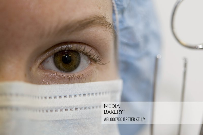 Close up of Female Doctor's Eye Wearing Surgical Mask
