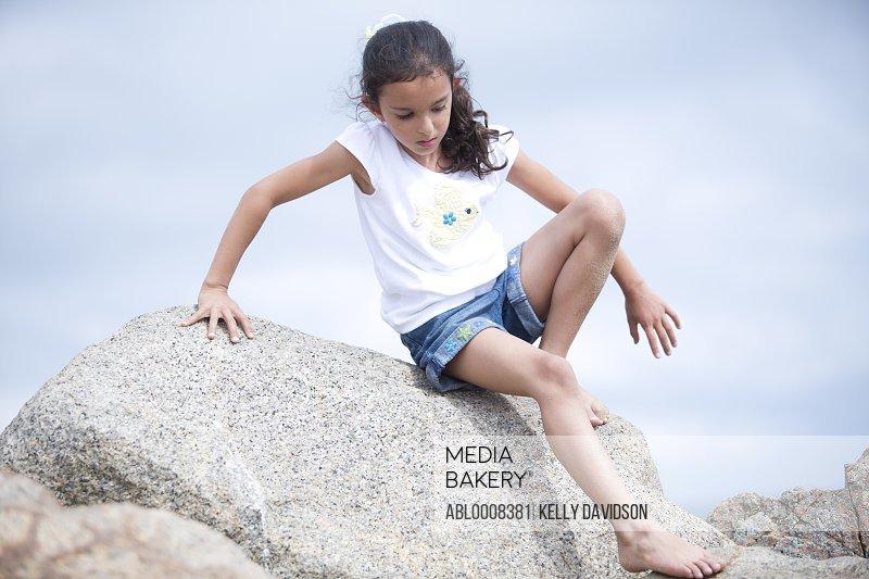 Girl Climbing Down Rock