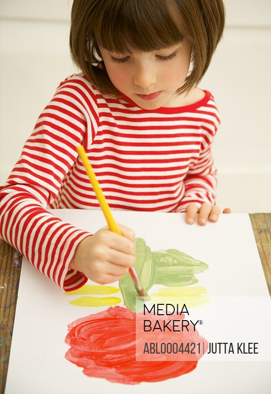 Portrait of a girl painting with watercolor