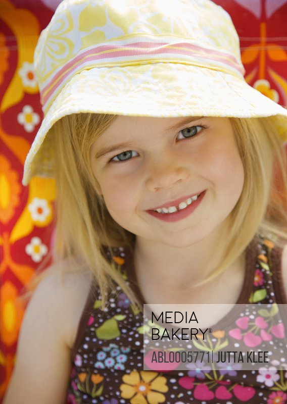 Smiling young girl wearing a hat