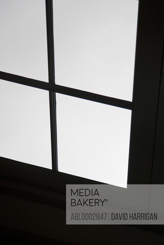 Window Reflecting on Black Surface