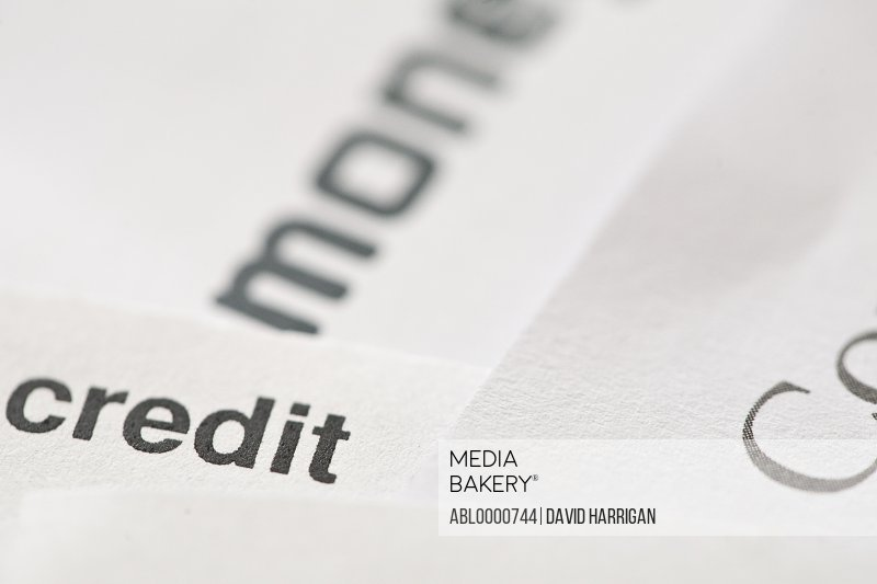 Extreme close up of letters and financial documents and the word credit