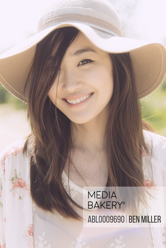 Young Woman Wearing Floppy Hat Smiling