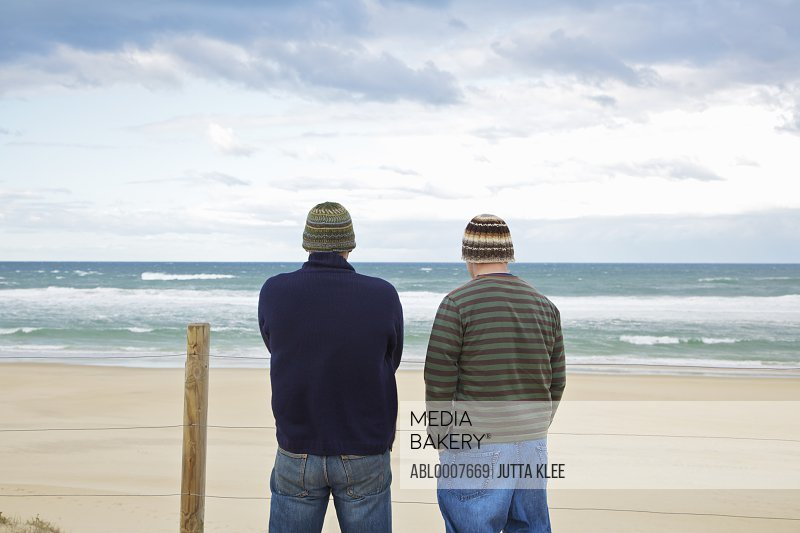Back View of Two Men Looking at the Ocean