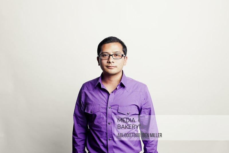 Man Wearing Purple Shirt
