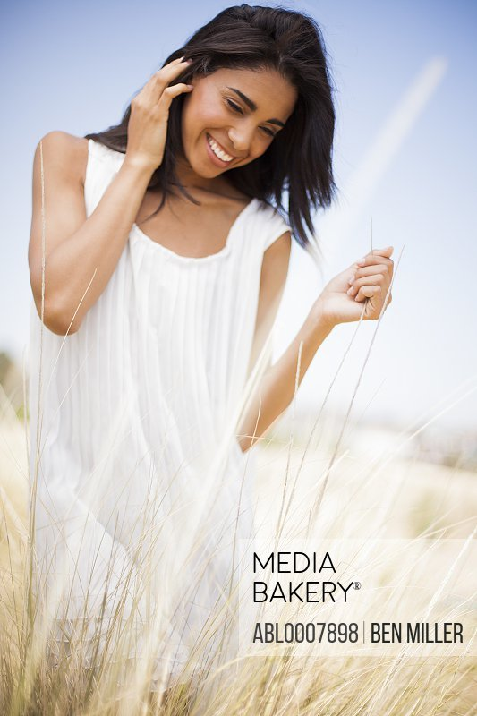 Smiling Woman in a Field of Tall Grass